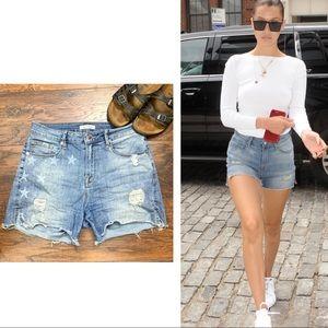 Good American•High waist denim cutoff shorts stars